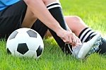Soccer_boots_being_tied1